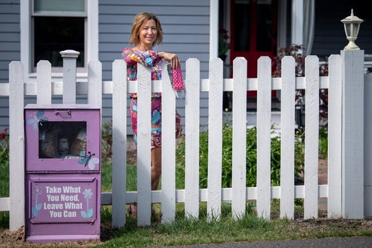 """Darla Bole stands with her homemade masks outside her home in Nashville, Tenn., Friday, April 17, 2020. Bole has used her free time to make hundreds of cloth masks for her East Nashville neighbors. """"I'm a sewer, I've been a sewer for years,"""" Bole said. Bole is not charging anyone for her masks. """"A lot of people can't believe that they're free, and I'm insisting they are,"""" she said. """"I've been telling everyone to just pay it forward."""""""