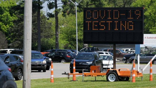Cars line up for coronavirus testing Saturday, April 18, 2020, at the Williamson County Health Department in Franklin, Tenn.