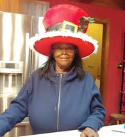 Marie Speakman, at a Christmas party in the Walmart where she works in suburban Atlanta.