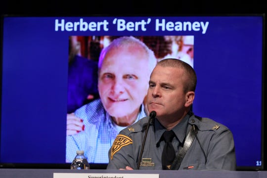 New Jersey State Police Superintendent Colonel Pat Callahan is shown in front of an image of Herbert 'Bert' Heaney.  Governor Phil Murphy recognized Heaney, forensic scientist at New Jersey State Police's North Regional Laboratory in Little Falls, during his Saturday, April 18, 2020, press conference at War Memorial in Trenton, NJ, on the State's response to the coronavirus.