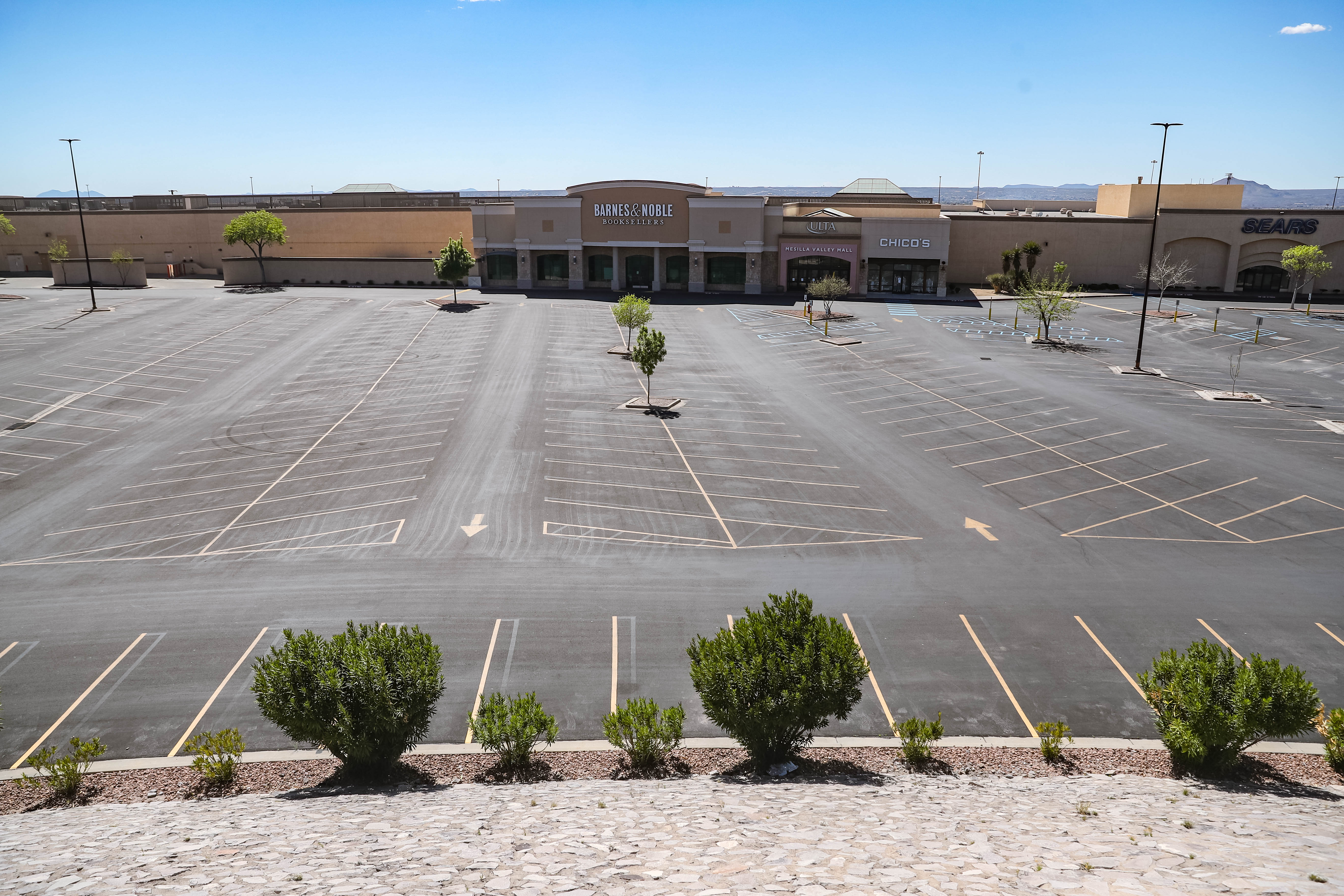 The parking lot of the Mesilla Valley Mall sits empty on Thursday, April 2, 2020, in front of Barnes and Noble in Las Cruces while all non-essential stores are closed during New Mexico's public health order.