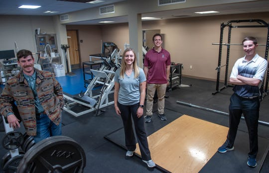 From left, New Mexico State University kinesiology students Cameron Munger, Bailey Jones, Isaac Halloran and Garrett Eggleston pose for a photo taken in early March at Rentfrow Hall. Munger, a doctoral student, recruited Jones, Halloran and Eggleston to help him with his research dissertation on eccentric muscle actions.