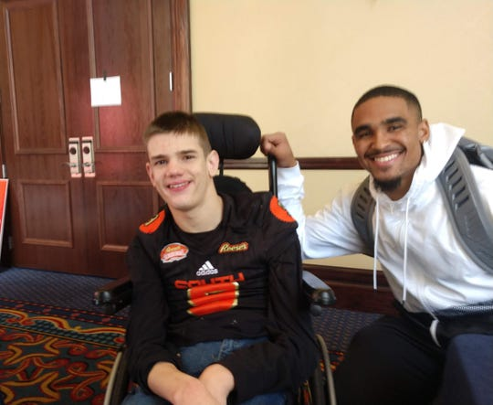 Matty Chestnutt poses with former Alabama and Oklahoma quarterback Jalen Hurts at the 2020 Senior Bowl in Mobile, Alabama.
