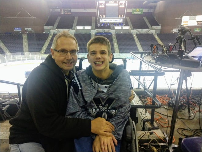 Paul and Matty Chestnutt take in a Pensacola Ice Flyers hockey game at the Pensacola Bay Center.