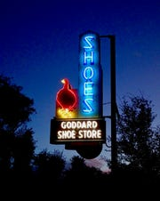 The Goddard Shoe Store sign features a distinctive red longneck goose, common to stores that once sold Red Goose shoes.