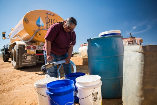 Despite DigDeep's work to bring running water to homes in the Navajo Nation, many Navajo people still must haul water in buckets and barrels from community water sources such as wells.