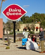 Newlyweds enjoy the Neon Sign Park as a photogenic backdrop.