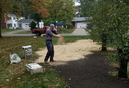 An employee at Brown's Dandi-Lawn seeds a customer's lawn in the Blue Water Area in this 2017 photo. The owners of Brown's are among the local business owners upset with the latest stay-home order that expanded what workers, such as in lawn care and landscaping, were considered nonessential during the coronavirus.