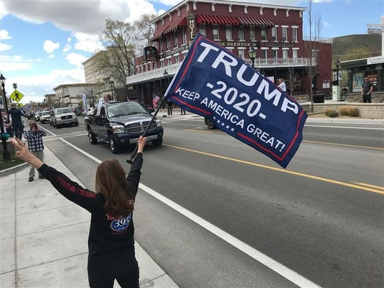 Residents gather at the state capitol in Carson City on Saturday, April 18, 2020, to protest Gov. Steve Sisolak's statewide shutdown. The protest was to promote reopening businesses.