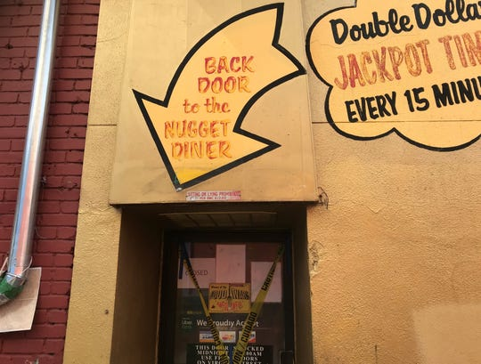 Locals take the rear entrance lying off Fulton Alley to get their Awful Awful fix at the Little Nugget diner in downtown Reno.