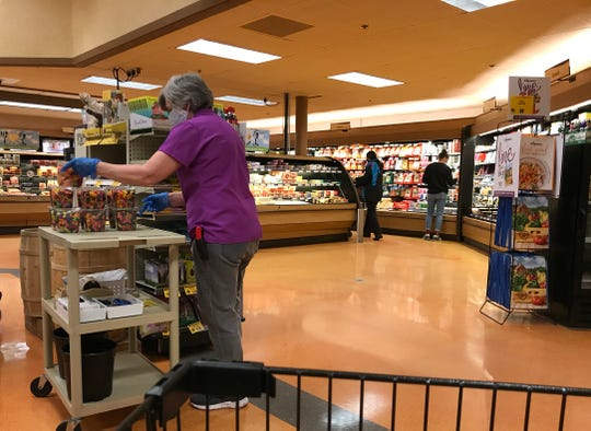 Staff and customers at Wegmans store on Hylan Dr. in Henrietta wore masks Saturday, April 17, 2020.  Gov. Andrew Cuomo's executive order went into effect Friday, April 17 at 8 p.m. that requires everyone to wear  a mask or a cover over the mouth and nose in public or in situations where social distancing can't be followed.
