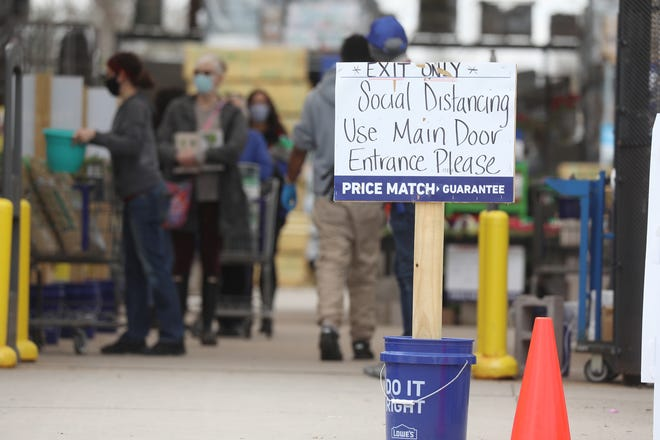 Staff and patrons at Lowe's home improvement store in Henrietta wore masks Saturday, April 18, 2020.  Gov. Andrew Cuomo's executive order went into effect Friday, April 17, at 8 p.m. that requires everyone to wear a mask or a cover over the mouth and nose in public or in situations where social distancing can't be followed.