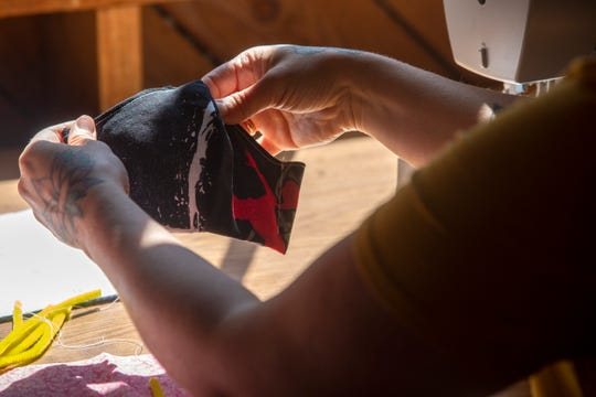 Volunteer Danielle Chayse, who has sewn hundreds of masks during the COVID-19 pandemic, continues it at the Dye House on the campus of the Willamette Heritage Center in Salem on April 17, 2020.