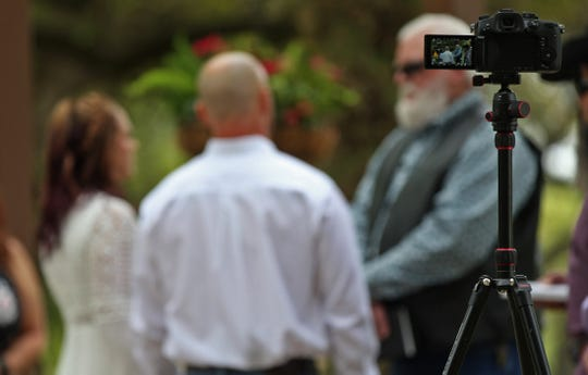 A camera is set up to live stream the wedding of Steve Brockman and Brenda Kirkland at the Christoval Vineyards and Winery on Saturday, April 18, 2020. Attendance at the wedding was limited due to restrictions in place because of the coronavirus.