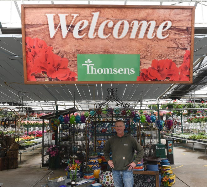 Thomsens Garden Center owner Arno Shermock poses for a photo in the recently reopened store Saturday, April 18, 2020, in St. Joseph.