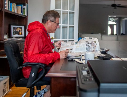 County Commission Chairman Bryan Desloge catches up on the latest news in the Wall Street Journal in his home office. Most mornings Desloge will go for a walk before beginning his day.