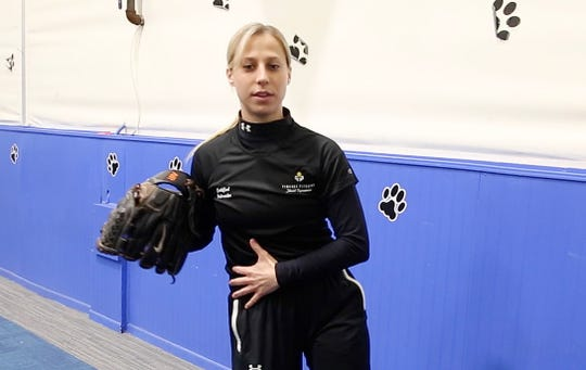 Pitching instructor Larissa Porcelli demonstrates training exercises that softball pitchers should be doing at home to stay in shape during the Coronavirus pendemic April 18, 2020.