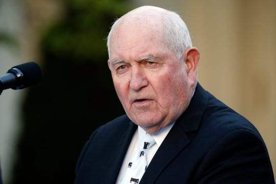 Agriculture Secretary Sonny Perdue speaks about the coronavirus in the Rose Garden of the White House, Wednesday, April 15, 2020, in Washington. (AP Photo/Alex Brandon)