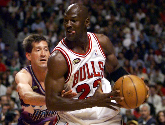 Chicago's Michael Jordan looks to make move on Utah's Jeff Hornacek in the 1998 NBA Finals.