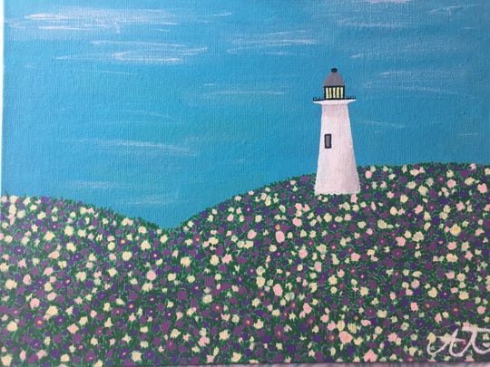 Alina Tran, a senior at East Haven High School in Connecticut, painted a lighthouse in a meadow as part of a prompt in her art therapy class. Like many teens, she's been dealing with the stress of school closures during the coronavirus pandemic.