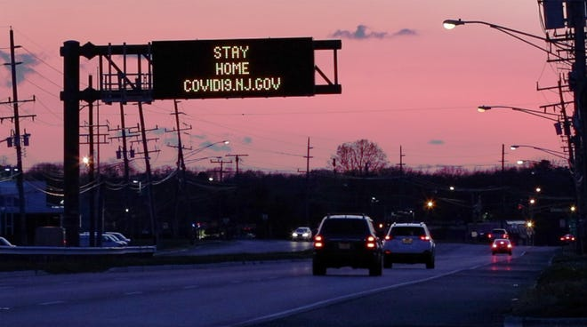 Light traffic flows along Route 37 in Toms River as the sun goes down during the Covid-19 shut-down.