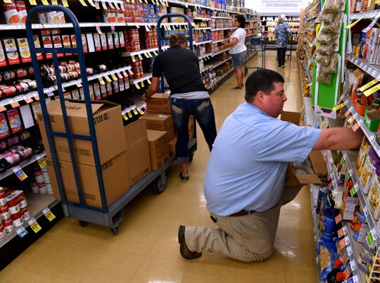 Turner Baugh, the assistant store director at United Supermarket in Breckenridge, stocks an aisle with grocery manager Nikki Couch March 27.