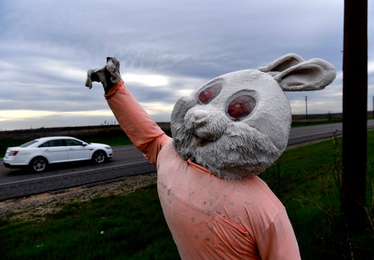 A car passes an Easter decoration on the stump mannequin along State Highway 70 south of Roby March 27. The statue, which is changed with the season, is dedicated to the memory of Dot Thompson.