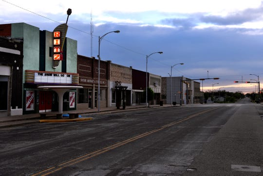 The marquee of the Ritz Theatre in Snyder March 27. The normally busy courthouse square was empty as restaurants had closed due to the pandemic.
