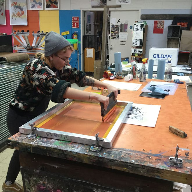 Ava Whitson, a University of Cincinnati fine arts student, learned about screen printing in a studio in Detroit. Whitson said remote learning during the pandemic can't replicate the hands-on experiences found in studios. As a result, Whitson believes tuition should be reduced.