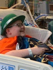 Joey Koslowski celebrates St. Patrick's Day from his bed at the Children's Hospital of Philadelphia