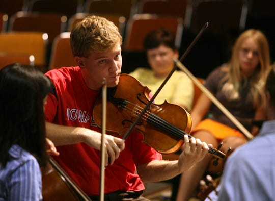 Valley graduate Adam Meyer plays in the Bryant Park Quartet. The New York-based Bryant Park Quartet performed for the Indian Hills 5th-8th grade orchestra students at Valley High School Monday.  REGISTER PHOTO/CONRAD SCHMIDT