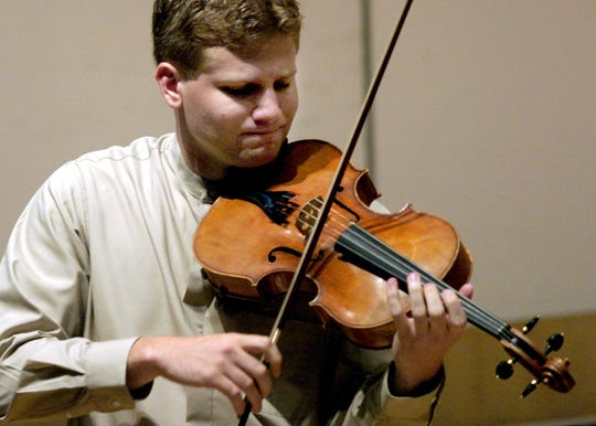 Valley High School graduate Adam Meyer plays his viola during An Evening Of Chamber Music at Sheslow Auditorium on the Drake campus in 2003