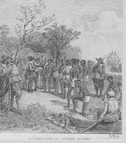 The quiet beginning of the slave trade in the United States is pictured in this undated engraving. The setting is Jamestown, Va., where in 1619 the captain of a Dutch ship traded 20 Africans for food in a deal with John Rolfe and other settlers. The Africans probably had been hi-jacked from a Spanish vessel. The 20 slaves were to grow to more than 15 million Africans imported and enslaved before the trade was stopped. (AP Photo/NY Public Library)