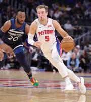 Pistons' Luke Kennard drives against Timberwolves' Josh Okogie on Nov. 11, 2019 at Little Caesars Arena.