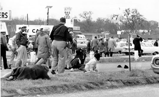 Civil rights demonstrators struggle on the ground as state troopers use violence to break up a march in Selma, Ala., on what is known as Bloody Sunday on March 7, 1965.  The supporters of black voting rights organized a march from Selma to Montgomery to protest the killing of a demonstrator by a state trooper and to improve voter registration for blacks, who are discouraged to register.  (AP Photo)