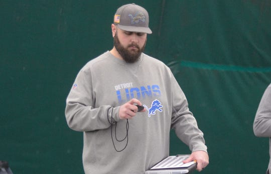 Ron Miles, the Lions' college scouting director, checks his stopwatch during Eastern Michigan's pro day last month.