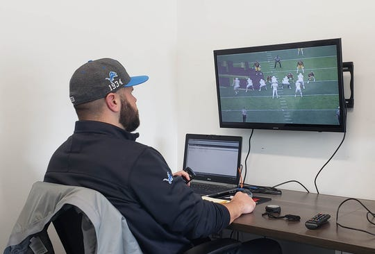 Ron Miles, the Lions' college scouting coordinator, watches film during a visit to Eastern Michigan last fall.