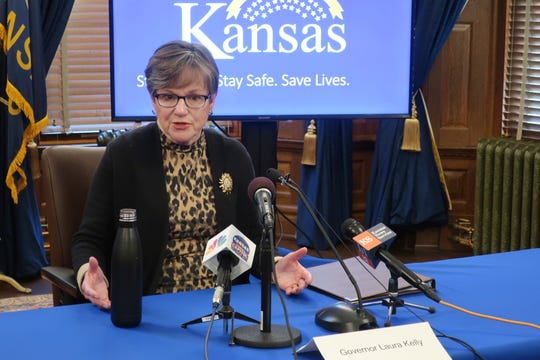 In this photo taken Wednesday, April 15, 2020, Kansas Gov. Laura Kelly answers questions about the coronavirus pandemic, during a news conference at the Statehouse in Topeka, Kan.