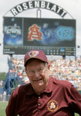 In this June 14, 2009, file photo, former Arizona State coach Bobby Winkles stands by home plate at Rosenblatt Stadium in Omaha, Neb. Winkles, the former baseball coach who won three national championships at Arizona State and went on to manage in the majors,  died on Friday. He was 90.