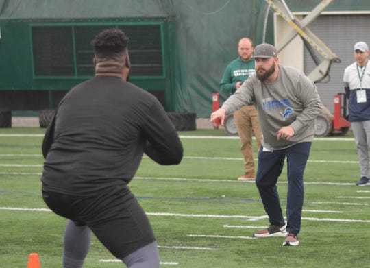 Ron Miles, the Lions' college scouting coordinator, works Eastern Michigan's pro day last month.