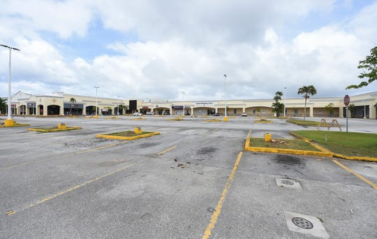 Sections of the Agana Shopping Center parking lot have been barricaded in Hagåtña during the COVID-19 pandemic on April 19, 2020.