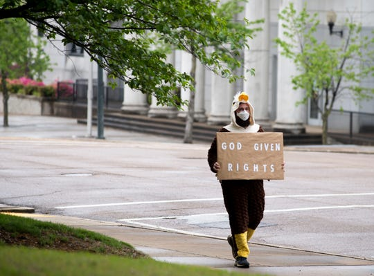 A Free Tennessee protest gathered around the Madison County court house, in Jackson, Tennessee, on April 19. Those at the sparsely attended gathering wore face masks and red, white, and blue colors.