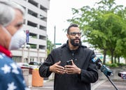 "Torian Whitlow talks to reporters at the ""Memphis Freedom Rally"" in violation of Mayor Jim Strickland's safer-at-home order during the coronavirus pandemic at City Hall in downtown Memphis,Tenn., on Sunday, April 19, 2020."