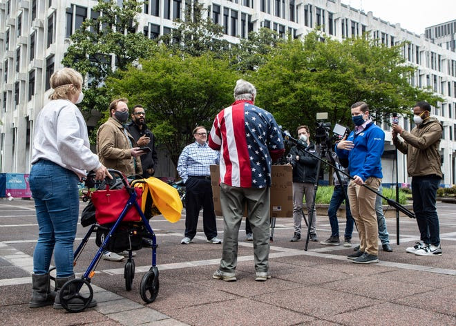 Hal Rounds of Fayette County talks to reporters at Sunday's Memphis Freedom Rally.
