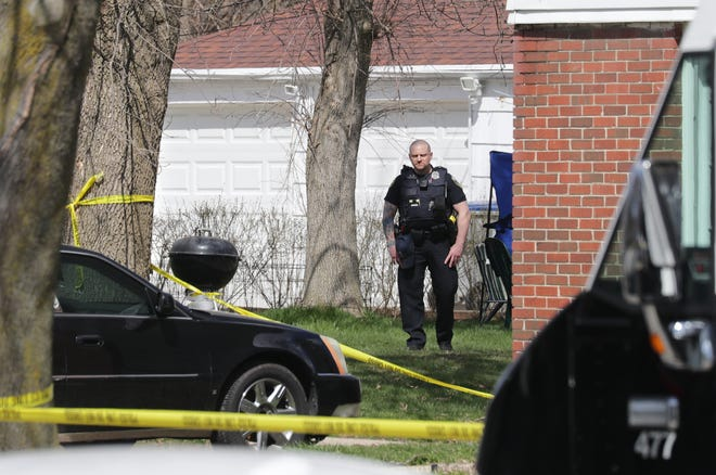 Police investigate at West Cleveland Avenue near South 45th Street in Milwaukee.