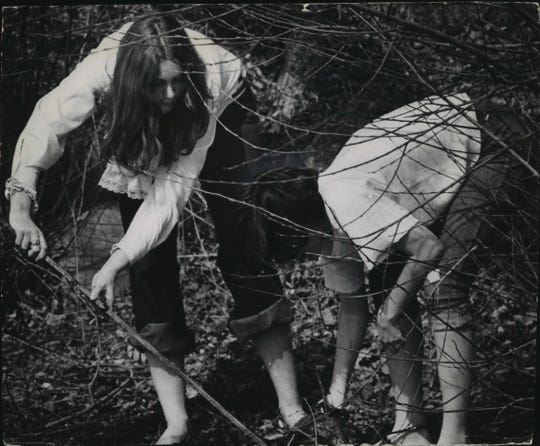 Irene Delmer, left, and Sandra Compton help clean up the bank of the Milwaukee River at Hubbard Park in Shorewood on April 22, 1970, the first celebration of Earth Day. The girls were in a group from Shorewood High School. This photo was published in the April 23, 1970, Milwaukee Journal.
