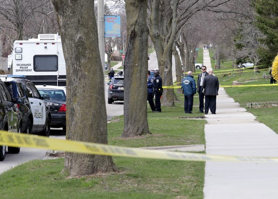 Police investigate an incident on West Cleveland Avenue near South 45th Street in Milwaukee on Sunday.