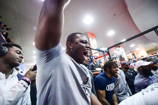 Auburn defensive end Marlon Davidson cheers on teammates  during Auburn's 2020 Pro Day on March 6, 2020.