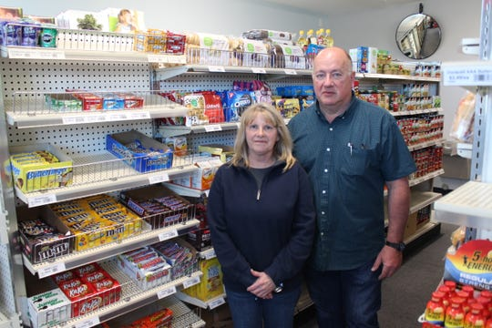 Nancy and Eric Anderson are pictured in the Crown City Market on Wednesday, April 15, 2020. The grocery store opened ahead of schedule to meet the community's need in the wake of the COVID-19 pandemic.