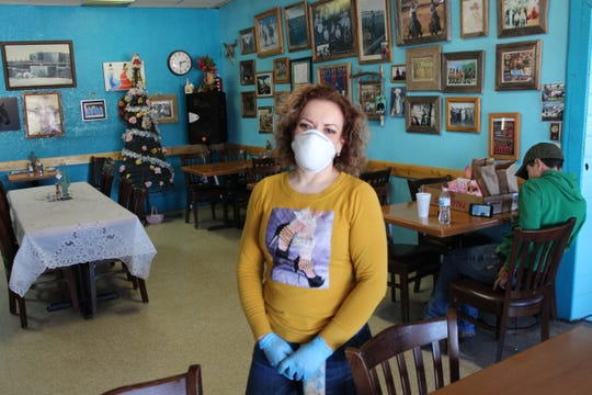 Cristina Beltran is pictured inside the El Corral Cafe on Wednesday, April 15, 2020. The popular cafe in Corona, N.M., has seen an 80 percent decrease in business after it was forced to shift to a carry-out model in the wake of the COVID-19 outbreak.